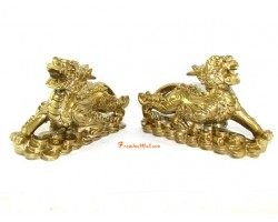 Pair of Golden Piyao on Bed of Coins