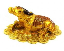 Bejeweled Bull Resting on a Bed of Coins