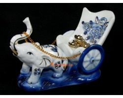 Porcelain Elephant Pulling a Carriage with Gold Ingots