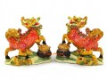 Pair of Vibrant Chi Lin on Pots of Gold Ingots